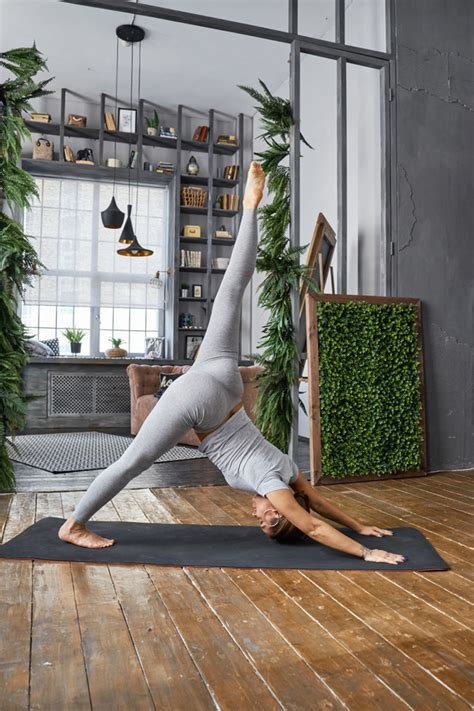 living room yoga woman practicing yoga in the living room stock photo 12