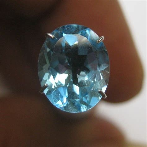 Topaz Swiss 24 Carat Warna Tajam batu permata topaz vsi swiss blue oval 2 64 carat