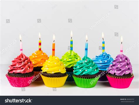 rainbow cake and cupcakes decorated with birthday candles rows colourful cup cakes decorated birthday stock photo 282625757