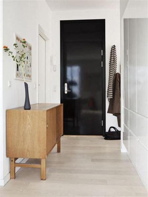 white floor light black interior door with white walls and light floor