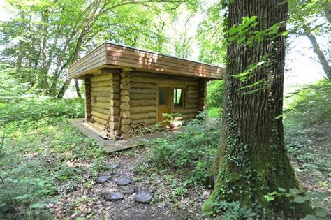 a log cabin in the forest home design garden