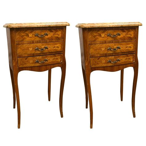 pair of three drawer marble top bedside or end tables for