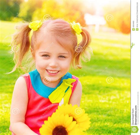 Sweet Child with sunflowers bouquet stock photography