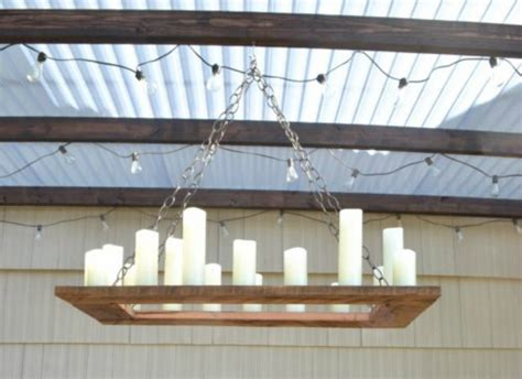 make an outdoor rustic chandelier remodelaholic how to make your own rustic candle outdoor chandelier