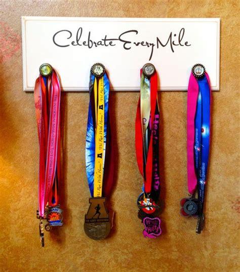 marathon half marathon running medal display by