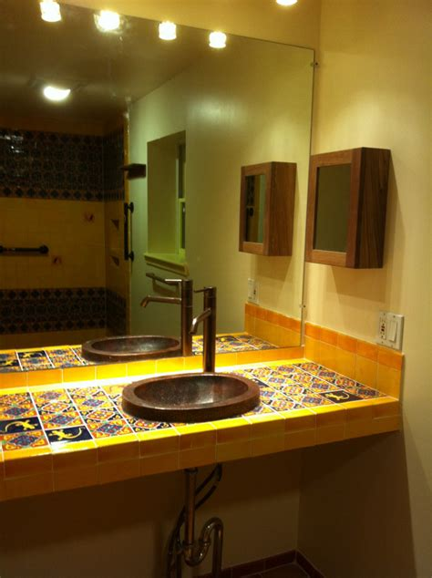 bathroom copper sink on a mexican tile vanity top mexican