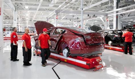 Tesla Motor Corp Ex Workers Sue Tesla Drawings Slurs At Bay