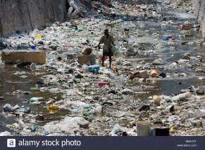 looking a garbage filled river port au prince haiti