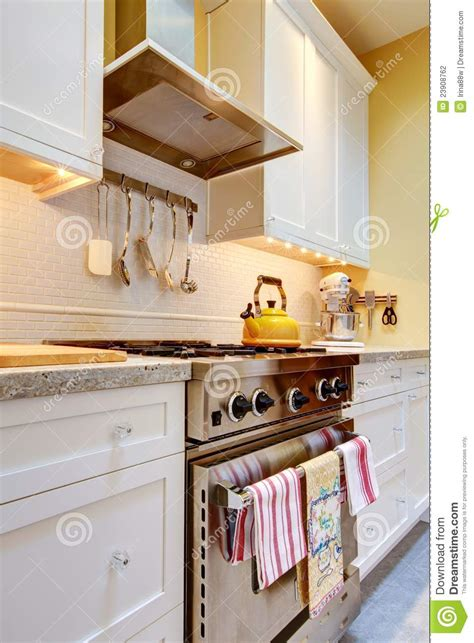 yellow kitchen with white cabinets yellow kitchen with white cabinets and stove stock