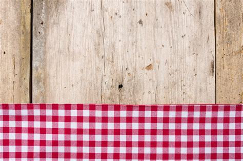 wood pattern tablecloth red checkered tablecloth on a wooden background stock