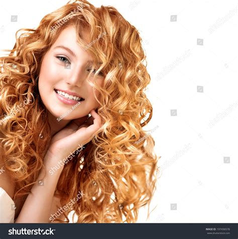 tween pink highlights curly hair beauty teenage model girl portrait isolated stock photo