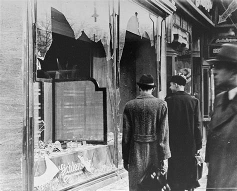 kristallnacht the history and legacy of germany s most notorious pogrom books file germans walk by a business destroyed on