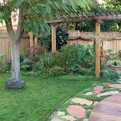 Backyard makeover includes new path pergola and pond