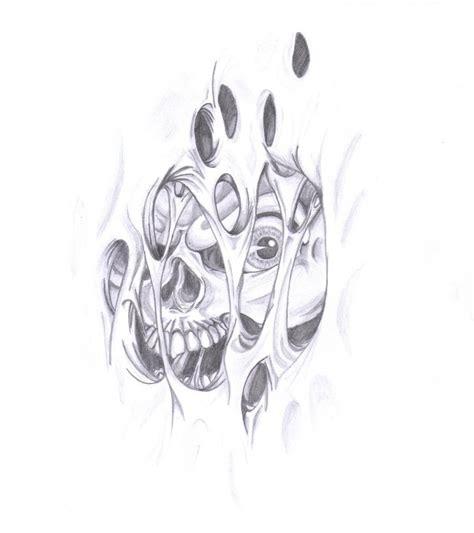 torn skin tattoos