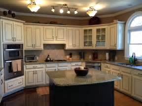 Almond Kitchen Cabinets by Black Distressed Island And Cream W Almond Glazed Kitchen