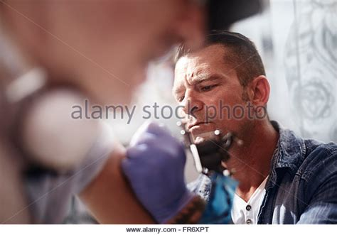focused tattoo tattooing stock photos tattooing stock images alamy