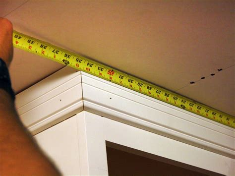 How To Put Crown Molding On Kitchen Cabinets How To Install Kitchen Cabinet Crown Molding How Tos Diy