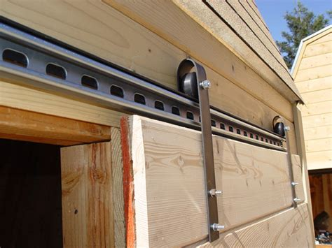 Sliding Door Hardware For Shed by Make Sliding Barn Doors Using Skateboard Wheels 7 Steps