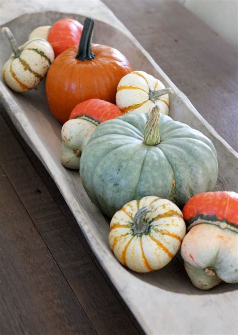 kitchen table centerpiece bowls vintage bread dough bowl filled with pumpkins and gourdes