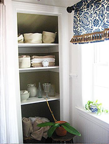 Take The Door Off Your Bathroom Linen Closet For A Chic Bathroom Closet Shelving