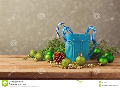 how many copies of a cup of christmas tea sold decorations with blue cup and on wooden table with copy space stock photo