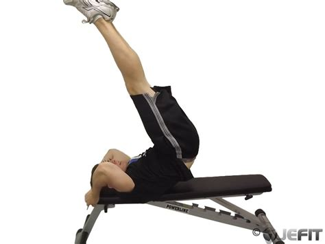 leg raise on bench lying leg raise with hip thrust on bench exercise