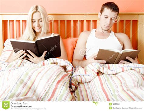 reading in bed couple reading in bed stock photos image 12892903
