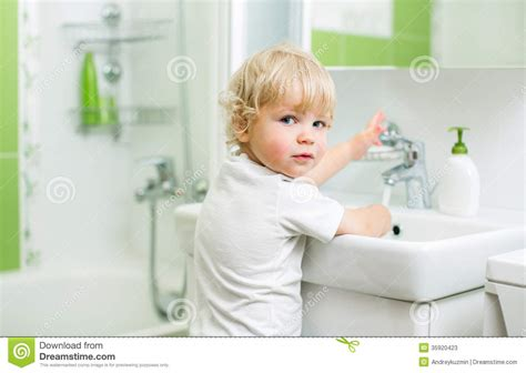 kid in bathroom kid washing hands in bathroom stock photos image 35920423