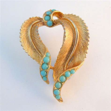 vintage sphinx faux turquoise curved leaf brooch