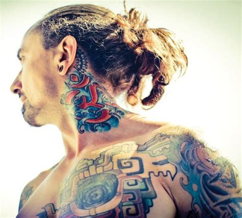 tattoo and hot yoga justin kaliszewski with quot om quot on his neck yoga inspired
