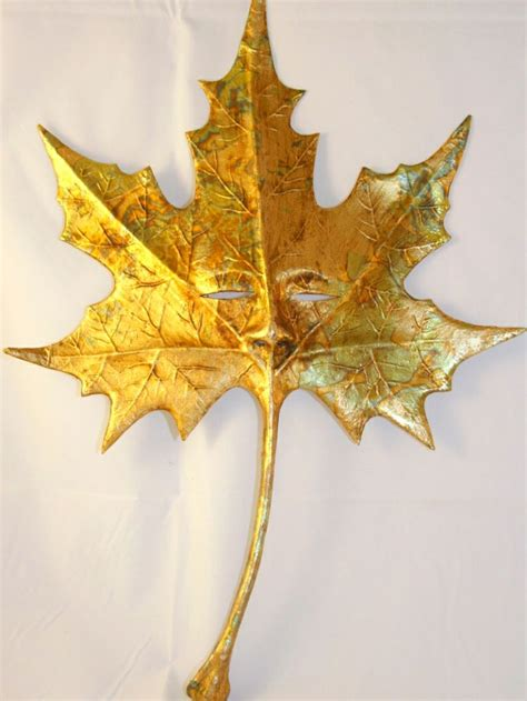 printable leaf mask foglia oro is an elegant mask to be used as a handheld
