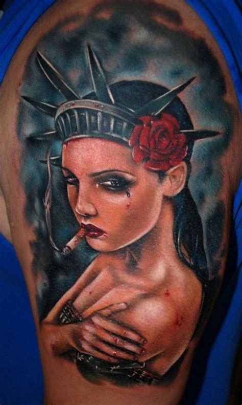 statue of liberty pin up tattoo tattoo s by richie cool statue of liberty tattoo by kyle cotterman tattoomagz