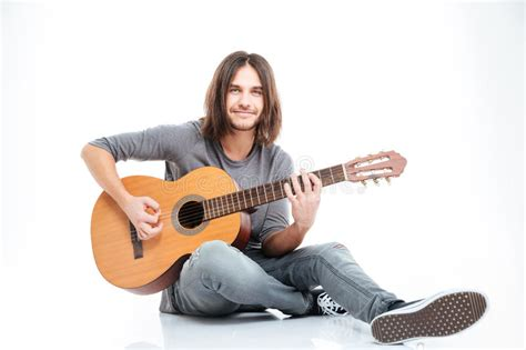 who is the man with guitar in the direct tv commercial smiling young man sitting on the floor and playing guitar