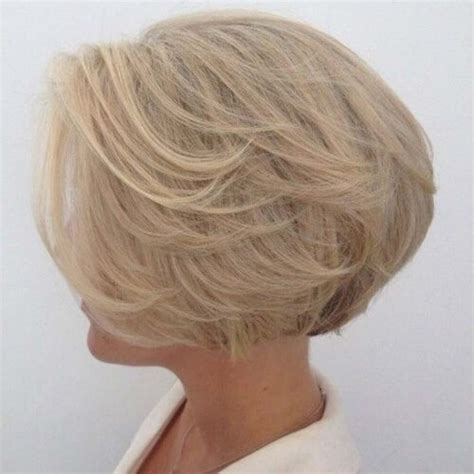 medium feathered bob feather layered bob hairstyle the shizz signature