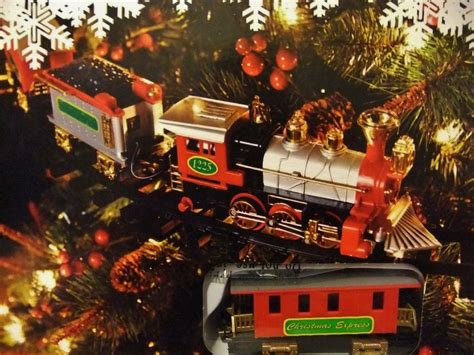 holiday railroad train set around the tree christmas