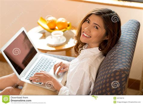 woman in armchair woman in armchair stock photo image 43733216