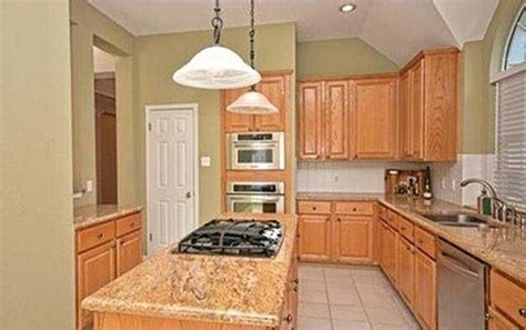 tan kitchen cabinets what color to paint cabinets and walls for tan granite