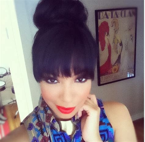 black hairstyles with bun and bangs bangs and high bun love evelyn lozada rocked it best