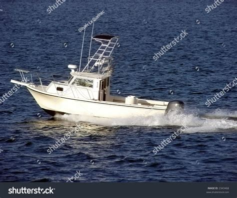 deep sea fishing boat with cabin small white fishing boat with cabin sailing at sea over