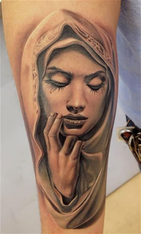realistic looking colored arm tattoo of sad woman face