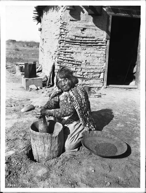 File:Mojave Indian woman pounding mesquite beans in a