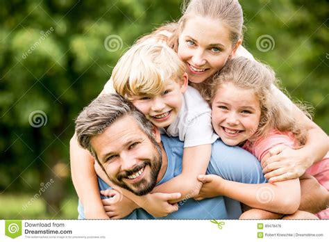 happy family garden happy family with two hugging stock photo image