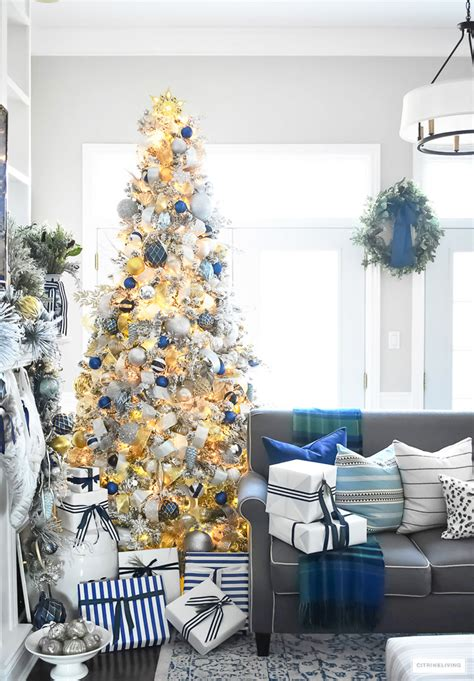 blue and silver cone christmas tree flocked tree with navy light blue silver and gold ornaments