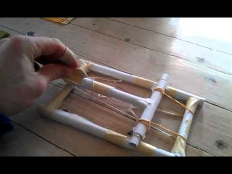 How To Make A Catapult Out Of Paper - paper catapult shooting orange seed