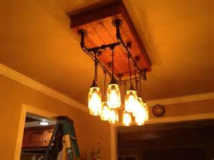 diy pipe chandelier wanted to work with iron pipe jars and cloth wire