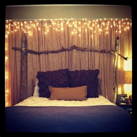 canopy lit up with christmas lights over bed love this