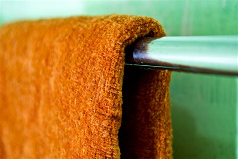 how to fold bathroom towels for hanging how to fold bath towels for quick hanging at home 4 steps