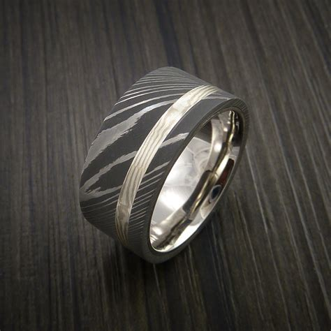 wide damascus steel and mokume ring with palladium sleave