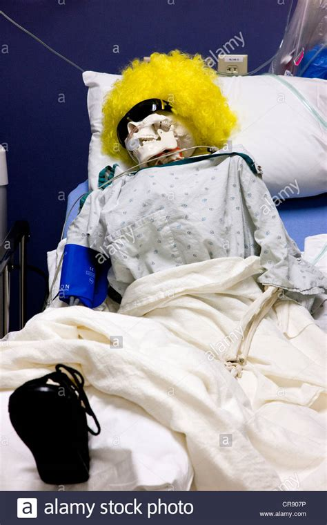 skeleton in bed hospital patient in bed a skeleton with yellow wig stock