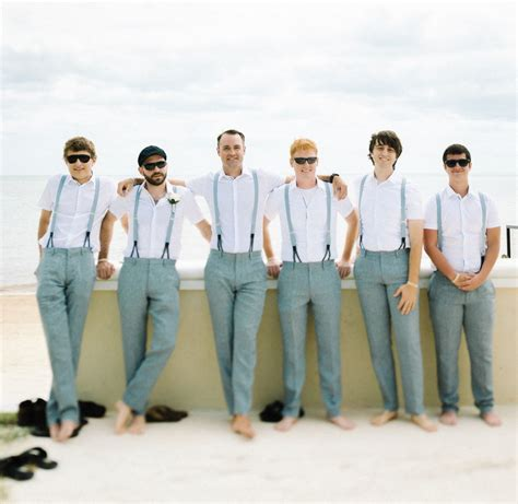 mens wedding attire with suspenders groomsmen at a wedding with grey slacks and light